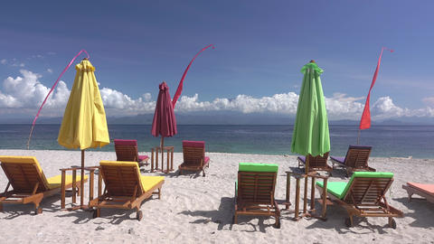 Empty Sunbeds and Umbrellas on the Beach. Fast Motion Footage