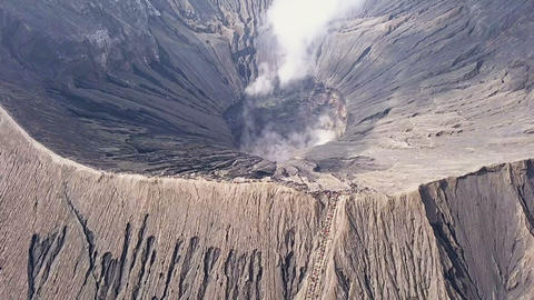 Active Volcano and Tourists on the Caldera. Aerial View Footage