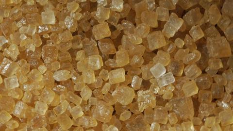 Brown sugar from sugar cane,rotating Live Action