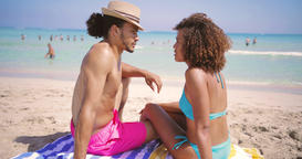 Couple resting on beach at the ocean Footage