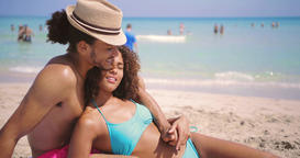 Couple embracing and relaxing on beach Footage