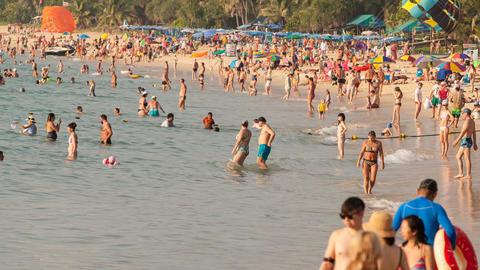 Phuket, Thailand- Febuary 21, 2018: People bathe in the sea and sunbathe on Footage