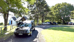 Shot of hearse arriving or leaving a funeral Footage