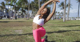 Relaxed black woman doing exercise in park Footage
