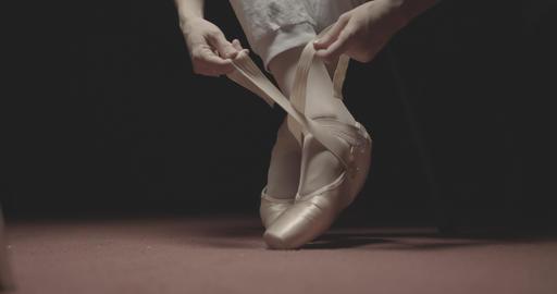 Ballet dancer putting on her ballet shoes Footage