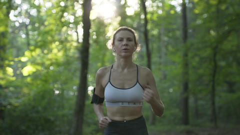 Athletic Woman Running in the Morning Woods Footage