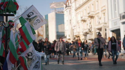 Bulgarian flags waving in downtown with people walking by Image