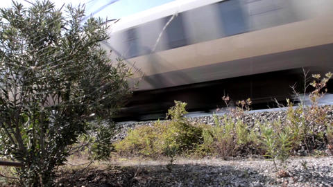 High speed train passing through green bushes 57 Footage