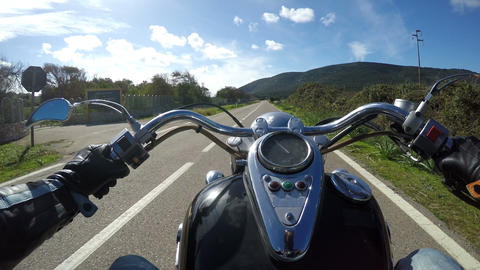 classic motorcycle riding on a straight road in Capo Caccia. Alghero, Italy Footage