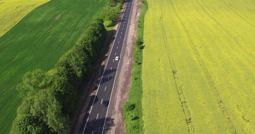 Flying Over the Road Trafic in a Field Live Action