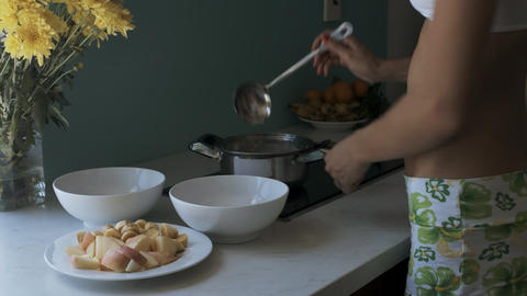 Woman Stands by Stove Cooks Dinner for Family Footage