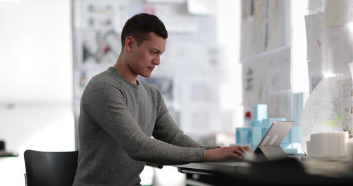 Young adult male working in creative office Stock Video Footage