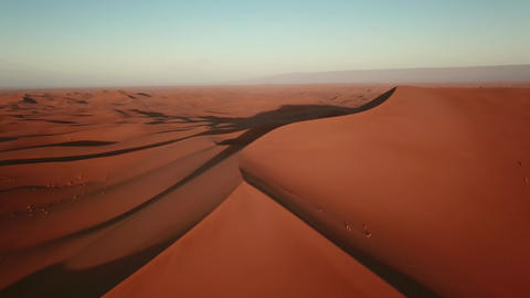Aerial of sand dunes in Sahara desert at sunrise Footage