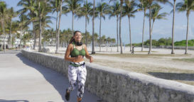 Sporty woman jogging in park Footage
