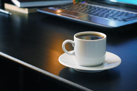 Coffee for work with laptop background フォト
