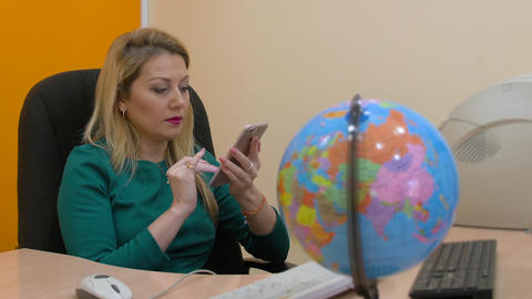 Business woman using mobile phone for browsing internet on workspace office Live Action