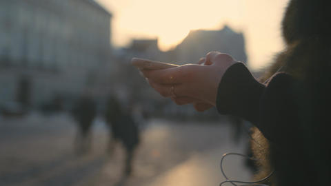 Woman hands using touchscreen phone outdoors in city ビデオ