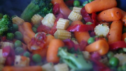 Stirring frying vegetables Footage