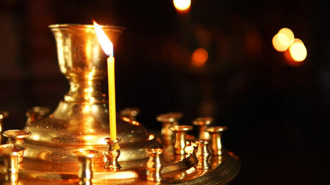 One candle in the candlestick of the Christian temple Footage