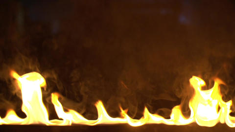 Super Slow Motion Of Clean Flames Igniting And Burning. A line of real flames ビデオ