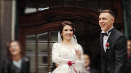Newlyweds leave the church and sweeps sweets sweetened Footage