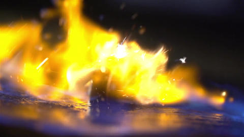 Ignition of gasoline with an electric lighter. The blue wave of fire moves to Footage