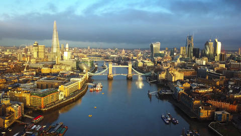 4K aerial skyline view of East London at sunrise with Tower Bridge and Footage