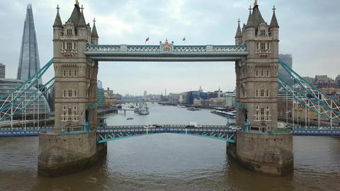 4K aerial footage of the famous Tower Bridge with traffic and famous skyscrapers Live Action