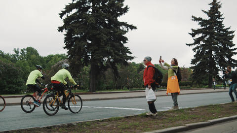 Running marathon leads by bicyclers managers on city road Footage