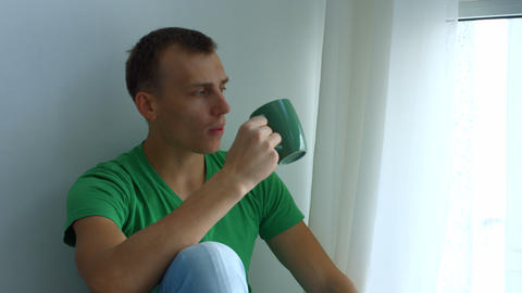 Portrait of thoughtful man drinking cup of tea Footage