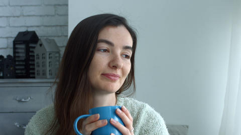 Romantic pretty woman drinking coffee at home Footage