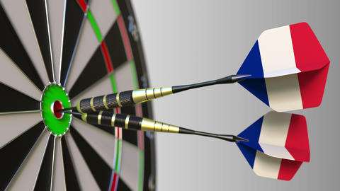 French national achievement. Flags of France on darts hitting bullseye Live Action