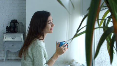 Lovely young woman relaxing in the morning at home Footage