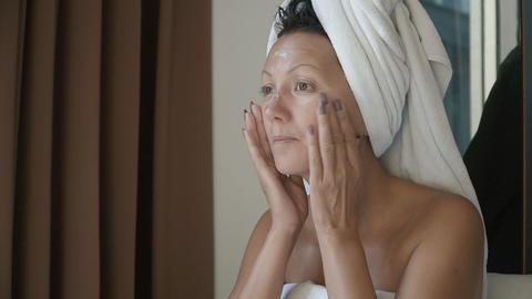 Woman applying skin cream Footage