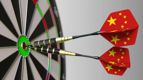 Chinese national achievement. Flags of China on darts hitting bullseye Live Action