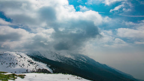 Mountains Peaks with Snow and Passing Clouds Image