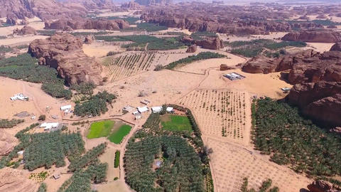 Al-Ula, Saudi Arabia. Overlooking the mountain valley landscale, and oasis area Footage