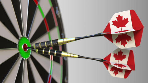 Canadian national achievement. Flags of Canada on darts hitting bullseye Footage