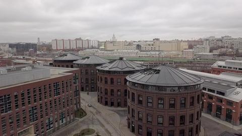 Brick facades circular shape of office buildings drone view ビデオ