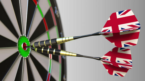 British national achievement. Flags of the United Kingdom on darts hitting Footage