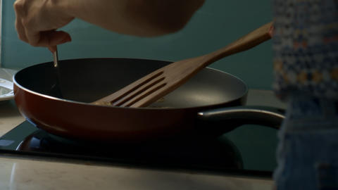 Girl in Dress Turns Tasty Pancakes on Large Pan Live Action