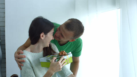 Man giving present to woman on Valentine's Day Footage
