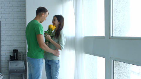 Loving man surprising his girlfriend with flowers Footage