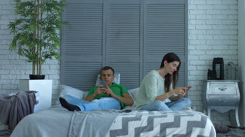 Couple addicted to smartphones phubbing at home Footage