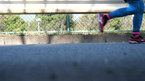 Feet of runners joining a road race in Tama City, Tokyo Live Action