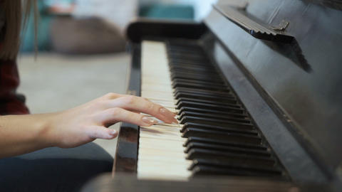 Young girl plays piano Footage