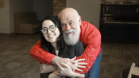 Mature man hugs granddaughter Footage
