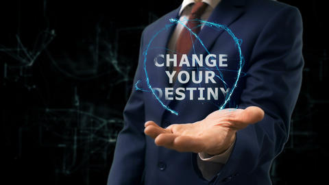 Businessman shows concept hologram Change your destiny on his hand Footage