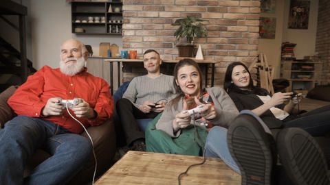 Company of friends plays video game together Footage