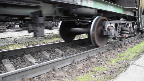 Movement of a freight train. Tanks on rails. Wheels of the train Footage